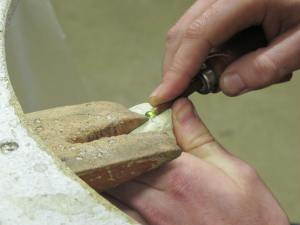 Setting the stone - a peridot.