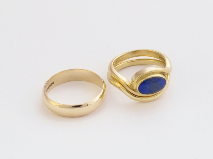 Wedding rings with black opal engagement ring