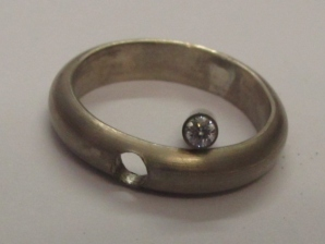 Ring and setting